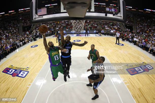 Eddie Basden of the 3 Headed Monsters drives the ball against Rasual Butler of the Power in week nine of the BIG3 threeonthree basketball league at...