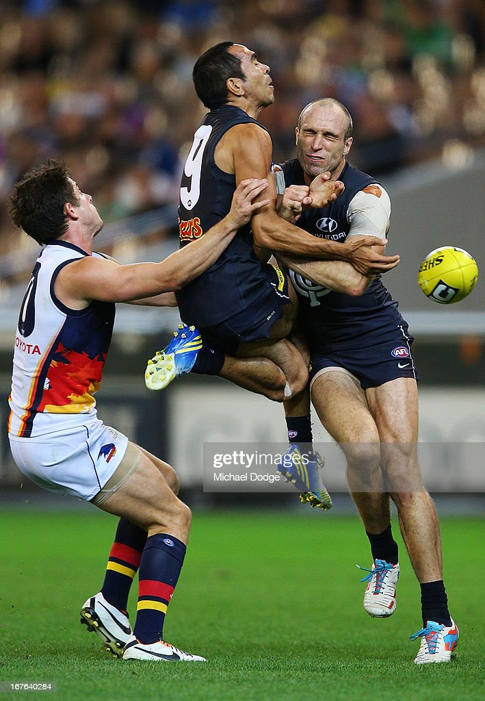 Eddie Betts (C) and Chris Judd of the Blues collide while contesting for the ball during the round five AFL match between the Carlton Blues and the Adelaide Crows at Melbourne Cricket Ground on April 27, 2013 in Melbourne, Australia.