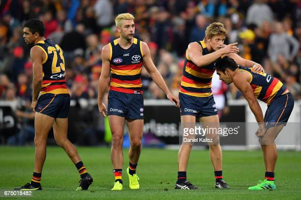 Eddie Betts and Rory Sloane of the Crows react at the half time siren during the round six AFL match between the Adelaide Crows and the Richmond...