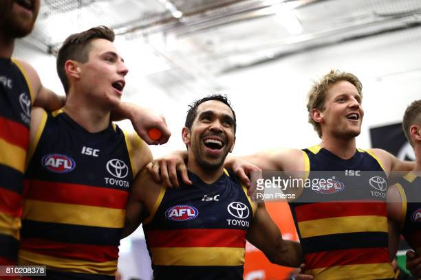 Eddie Betts and Rory Sloane of the Crows sing the club song after the round 16 AFL match between the Adelaide Crows and the Western Bulldogs at...