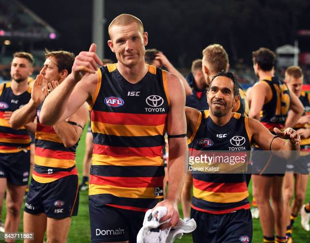 Eddie Betts and Sam Jacobs of the Crows celebrate as they walk from the ground after defeating the Greater Western Sydney Giant during the AFL First...