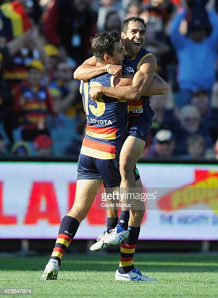 Eddie Betts and Taylor Walker of the Crows celebrate a goal during the round seven AFL match between the Adelaide Crows and the St Kilda Saints at...