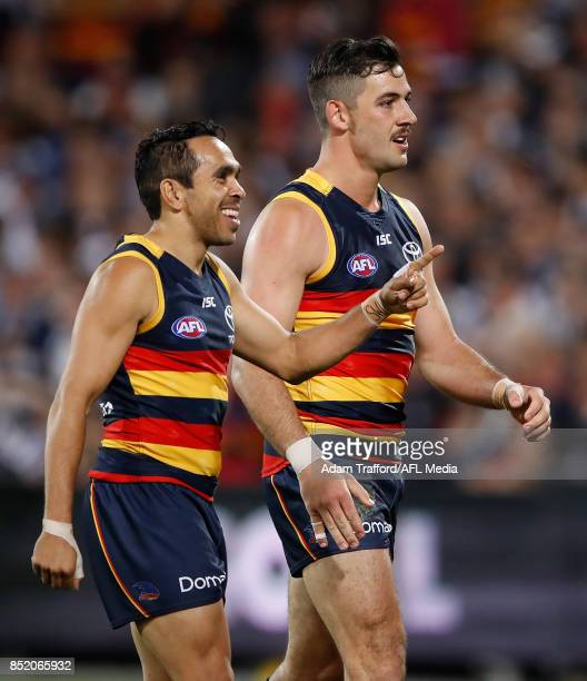 Eddie Betts and Taylor Walker of the Crows celebrate a goal from Josh Jenkins of the Crows during the 2017 AFL First Preliminary Final match between...