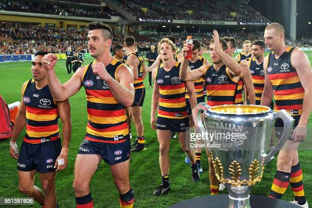 Eddie Betts and Taylor Walker of the Crows walk from the field after the First AFL Preliminary Final match between the Adelaide Crows and the Geelong...