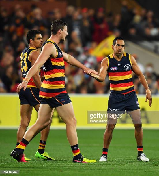 Eddie Betts is congratulated by Josh Jenkins of the Crows after kicking a goal during the round 12 AFL match between the Adelaide Crows and the St...