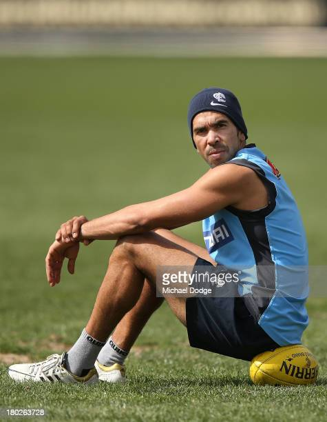 Eddie Betts looks ahead while sitting on a ball during a Carlton Blues AFL media training session at Visy Park on September 11 2013 in Melbourne...