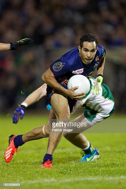 Eddie Betts of Australia and Zach Tuohy of Ireland in action during the International Rules 1st Test between Ireland and Australia at Breffni Park on...
