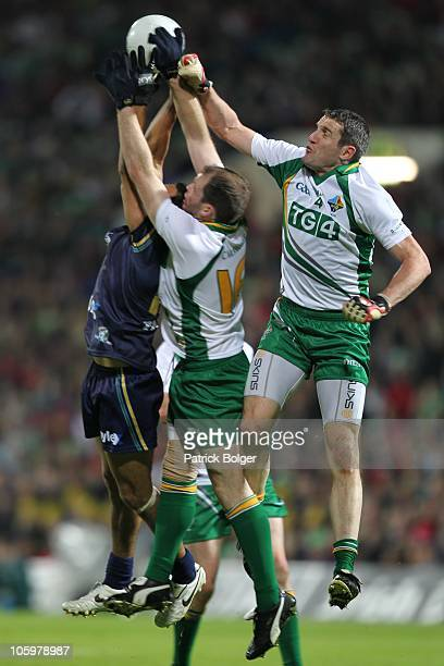 Eddie Betts of Australia competes with Ciaran McKeever and Graham Canty of Ireland during the International Rules series First Test between Ireland...