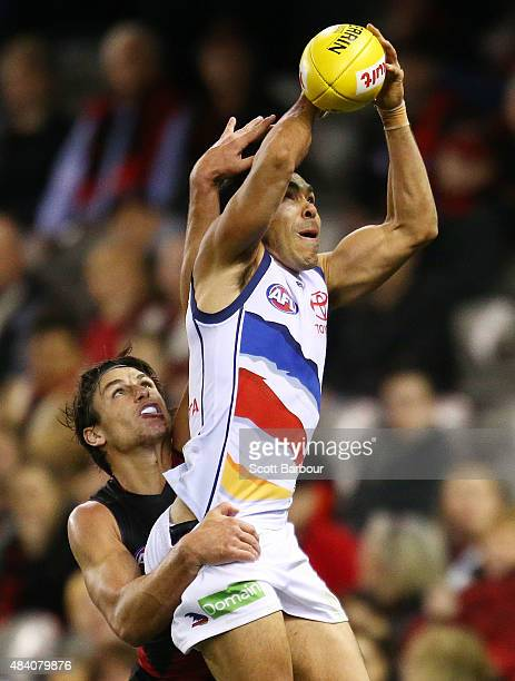 Eddie Betts of the Adelaide Crows takes a mark in front of Mark Baguley of the Essendon Bombers during the round 20 AFL match between the Essendon...