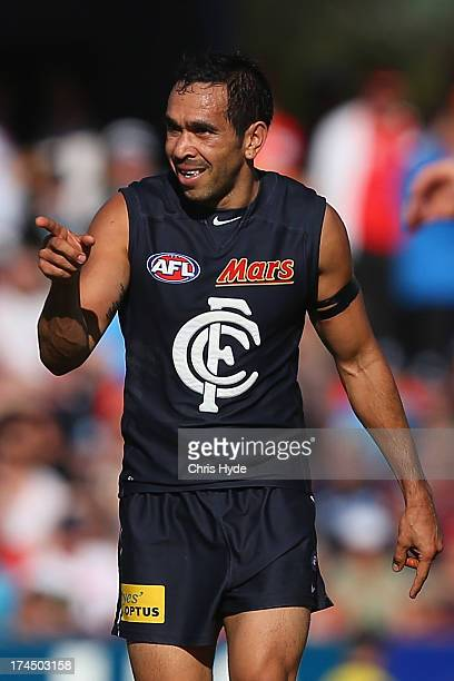 Eddie Betts of the Blues celebrates a goal during the round 18 AFL match between the Gold Coast Suns and the Carlton Blues at Metricon Stadium on...