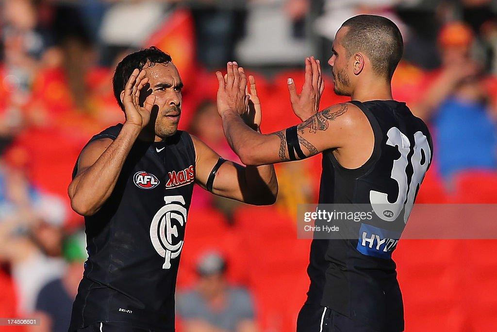 Eddie Betts of the Blues celebrates a goal with team mate Jeff Garlett during the round 18 AFL match between the Gold Coast Suns and the Carlton Blues at Metricon Stadium on July 27, 2013 in Gold Coast, Australia.