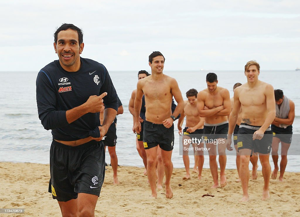 <a gi-track='captionPersonalityLinkClicked' href=/galleries/search?phrase=Eddie+Betts&family=editorial&specificpeople=546295 ng-click='$event.stopPropagation()'>Eddie Betts</a> of the Blues gestures as the Blues walk from the water during a Carlton Blues AFL Recovery Session at St Kilda Sea Baths on July 15, 2013 in Melbourne, Australia.