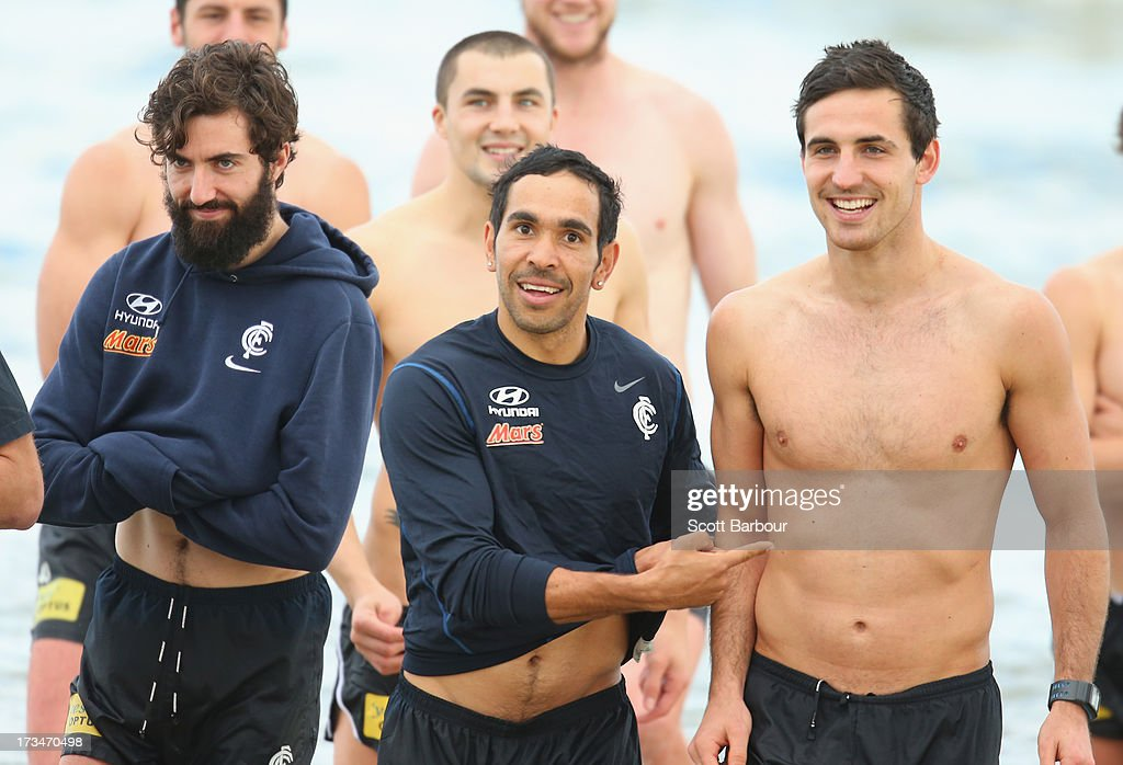 <a gi-track='captionPersonalityLinkClicked' href=/galleries/search?phrase=Eddie+Betts&family=editorial&specificpeople=546295 ng-click='$event.stopPropagation()'>Eddie Betts</a> (C) of the Blues gestures towards Kane Lucas (R) as Kade Simpson (L) looks on during a Carlton Blues AFL Recovery Session at St Kilda Sea Baths on July 15, 2013 in Melbourne, Australia.
