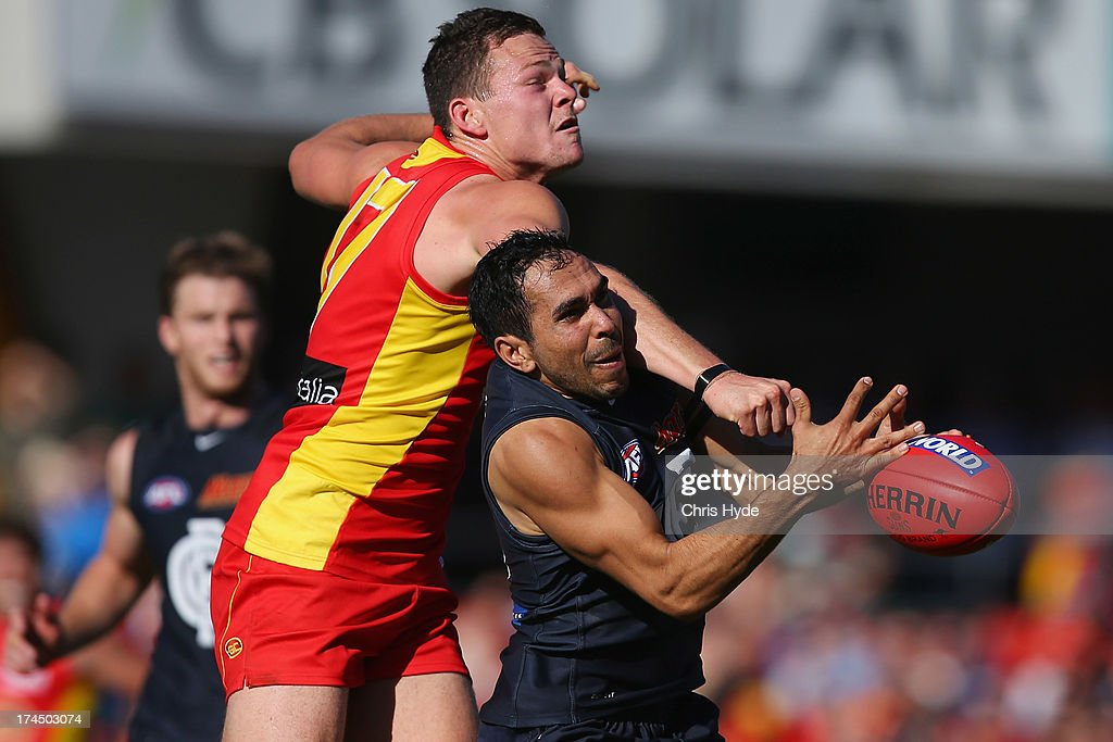 Eddie Betts of the Blues has a mark spoiled by Steven May of the Suns during the round 18 AFL match between the Gold Coast Suns and the Carlton Blues at Metricon Stadium on July 27, 2013 in Gold Coast, Australia.