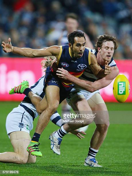 Eddie Betts of the Crows and Jed Bews of the Cats compete for the ball during the round 18 AFL match between the Geelong Cats and the Adelaide Crows...