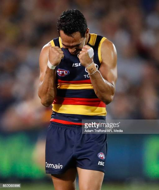 Eddie Betts of the Crows celebrates making it through to the grand final after asking the bench how long is left in the game during the 2017 AFL...