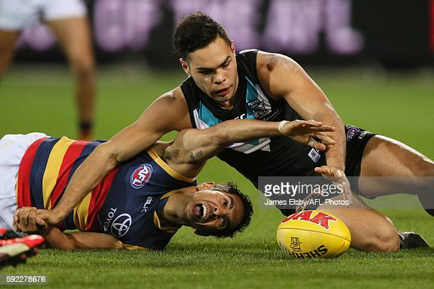 Eddie Betts of the Crows competes with Jarman Impey of the Power during the 2016 AFL Round 22 match between Port Adelaide Power and the Adelaide...