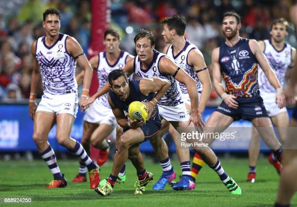 Eddie Betts of the Crows gathers the ball during the round 10 AFL match between the Adelaide Crows and the Fremantle Dockers at Adelaide Oval on May...