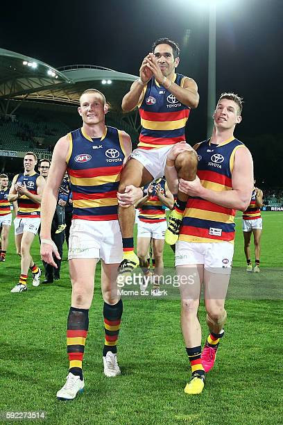 Eddie Betts of the Crows is chaired from the field by Sam Jacobs and Josh Jenkins after playing in his 250th AFL game during the round 22 AFL match...