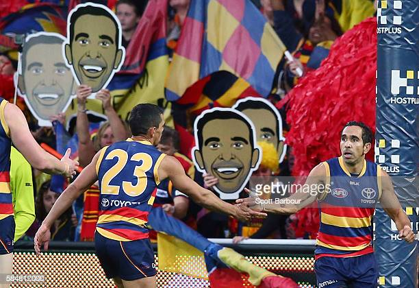 Eddie Betts of the Crows is congratulated by Charlie Cameron of the Crows after kicking a goal during the round 19 AFL match between the Adelaide...