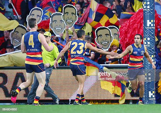 Eddie Betts of the Crows is congratulated by his teammates after kicking a goal during the round 19 AFL match between the Adelaide Crows and the...