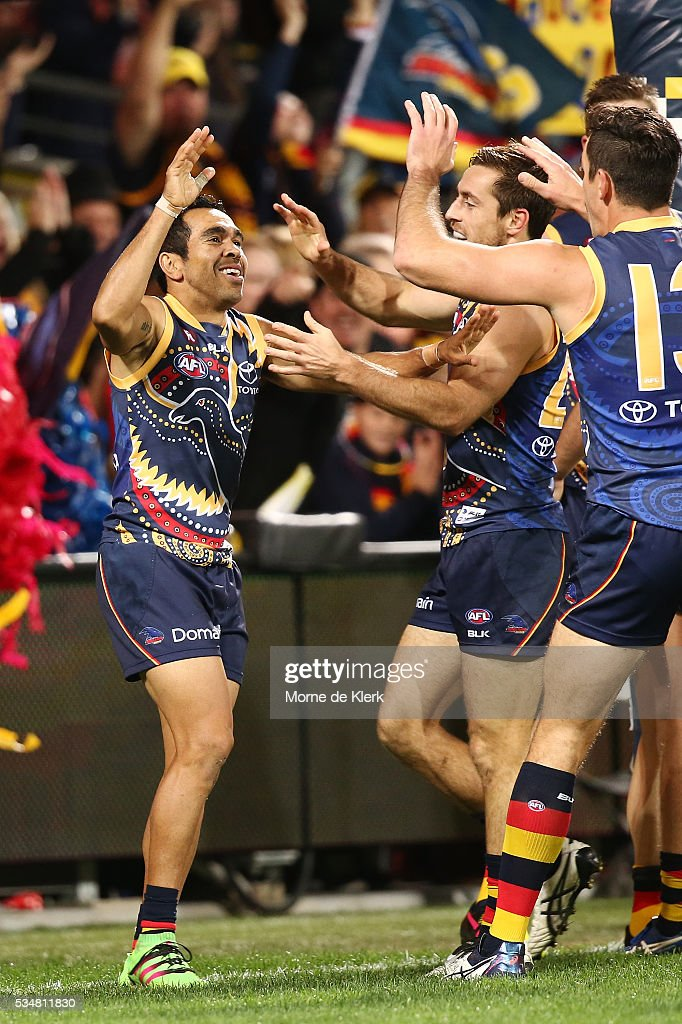 <a gi-track='captionPersonalityLinkClicked' href=/galleries/search?phrase=Eddie+Betts&family=editorial&specificpeople=546295 ng-click='$event.stopPropagation()'>Eddie Betts</a> of the Crows is congratulated by teammates after he kicked a goal in the last quarter of the game during the round 10 AFL match between the Adelaide Crows and the Greater Western Sydney Giants at Adelaide Oval on May 28, 2016 in Adelaide, Australia.