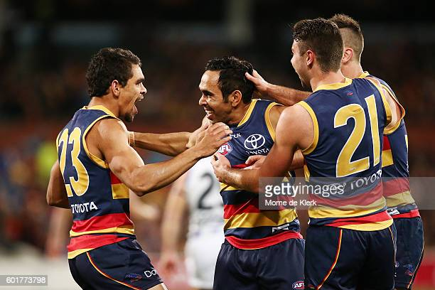 Eddie Betts of the Crows is congratulated by teammates after kicking a goal during the AFL 1st Elimination Final match between the Adelaide Crows and...