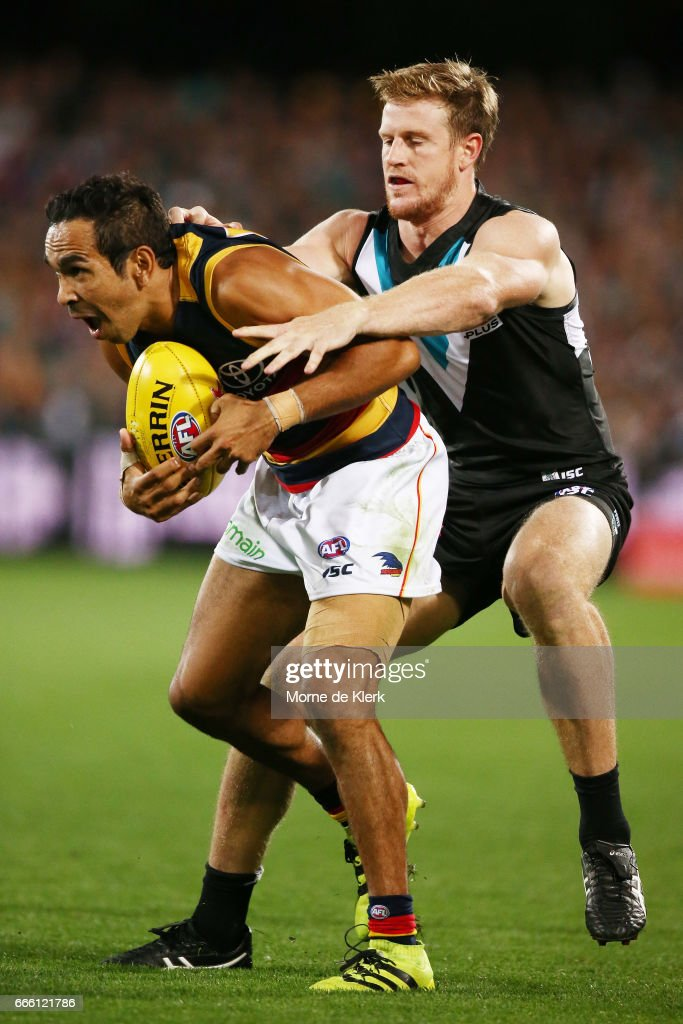 Eddie Betts of the Crows is tackled by Tom Jonas of the Power during the round three AFL match between the Port Adelaide Power and the Adelaide Crows at Adelaide Oval on April 8, 2017 in Adelaide, Australia.