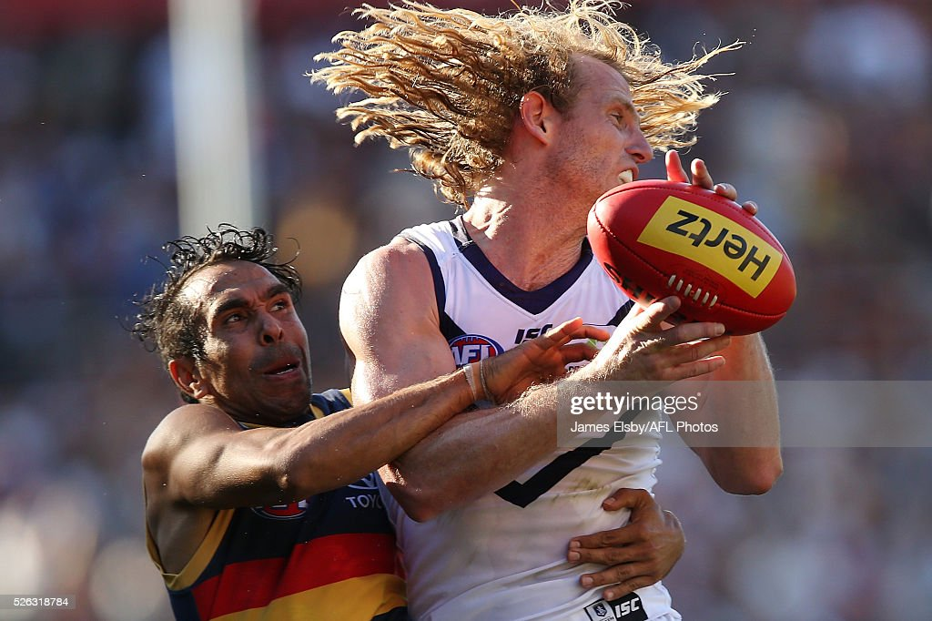 <a gi-track='captionPersonalityLinkClicked' href=/galleries/search?phrase=Eddie+Betts&family=editorial&specificpeople=546295 ng-click='$event.stopPropagation()'>Eddie Betts</a> of the Crows tackles David Mundy of the Dockers during the 2016 AFL Round 06 match between the Adelaide Crows and the Fremantle Dockers at Adelaide Oval, Adelaide on April 30, 2016.