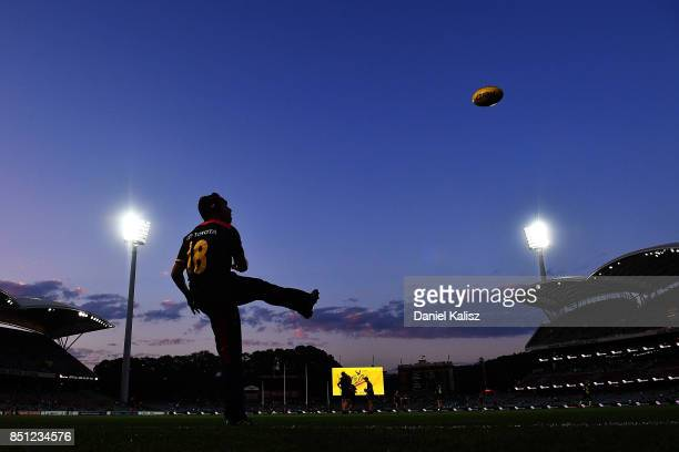 Eddie Betts of the Crows warms up kicking for goal prior to the First AFL Preliminary Final match between the Adelaide Crows and the Geelong Cats at...