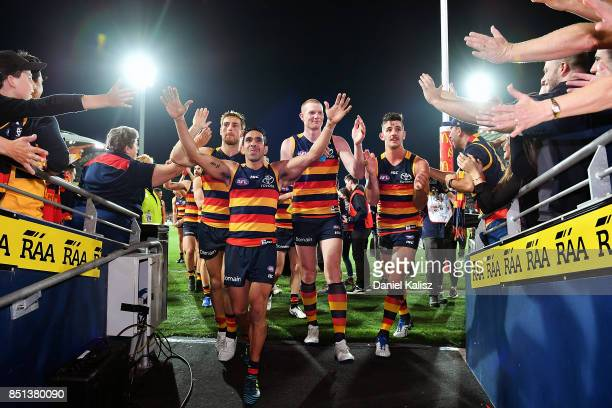 Eddie Betts Sam Jacobs of the Crows and Taylor Walker of the Crows walk from the field after the First AFL Preliminary Final match between the...