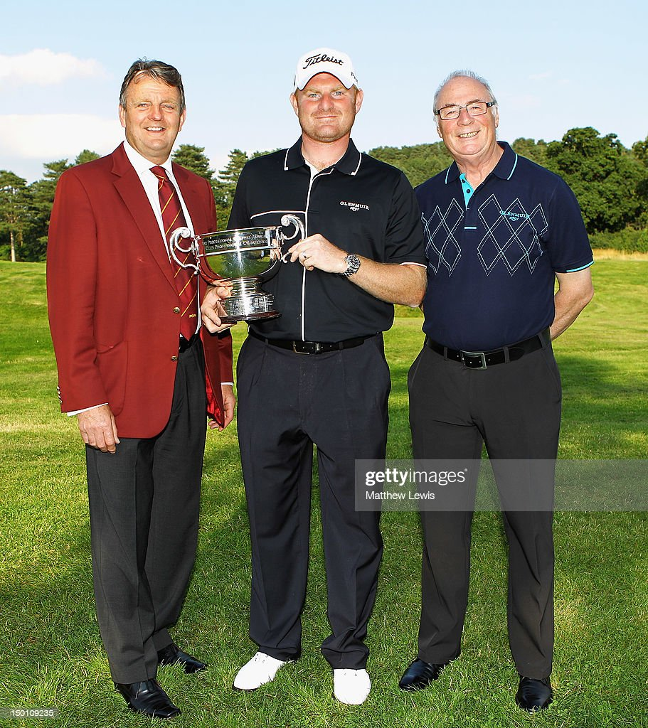 Eddie Bullock, Captain of the PGA and Colin Mee, Managing Director of Glenmuir pictured with Gareth Wright of West Linton Golf Club after winning the Glenmuir PGA Professional Championship at Carden Park Golf Club on August 10, 2012 in Chester, England.