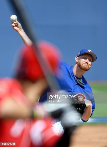 Eddie Butler of the Chicago Cubs pitches against Eugenio Suarez of the Cincinnati Reds during their exhibition game at Cashman Field on March 26 2017...
