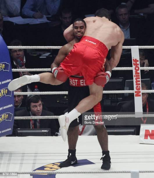 Eddie Chambers of USA laughts during he lifts up Wladimir Klitschko of Ukraine during their WBO Heavyweight World Championship fight between Wladimir...