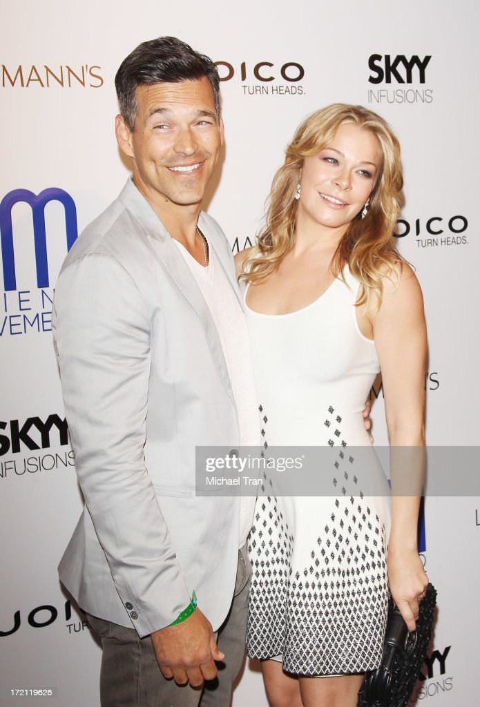 <a gi-track='captionPersonalityLinkClicked' href=/galleries/search?phrase=Eddie+Cibrian&family=editorial&specificpeople=689383 ng-click='$event.stopPropagation()'>Eddie Cibrian</a> (L) and LeAnn Rimes arrive at the Friend Movement Campaign benefit concert held at El Rey Theatre on July 1, 2013 in Los Angeles, California.