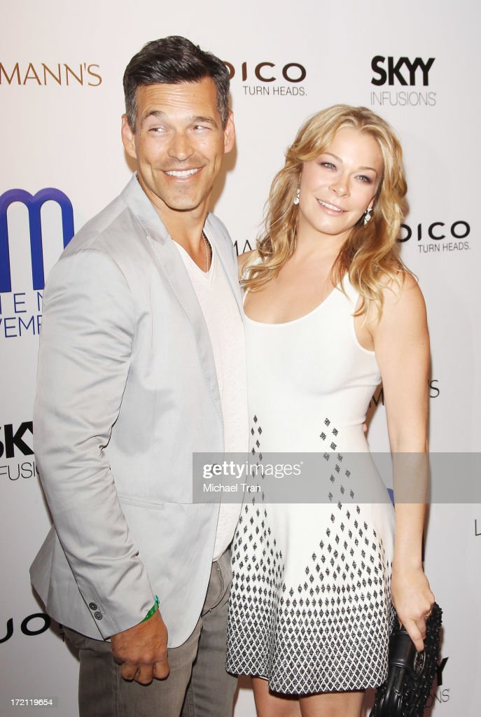 <a gi-track='captionPersonalityLinkClicked' href=/galleries/search?phrase=Eddie+Cibrian&family=editorial&specificpeople=689383 ng-click='$event.stopPropagation()'>Eddie Cibrian</a> (L) and <a gi-track='captionPersonalityLinkClicked' href=/galleries/search?phrase=LeAnn+Rimes&family=editorial&specificpeople=208815 ng-click='$event.stopPropagation()'>LeAnn Rimes</a> arrive at the Friend Movement Campaign benefit concert held at El Rey Theatre on July 1, 2013 in Los Angeles, California.