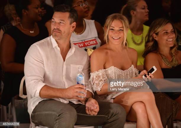 Eddie Cibrian and LeAnn Rimes attend Luli Fama fashion show during MercedesBenz Fashion Week Swim 2015 at The Raleigh on July 20 2014 in Miami Beach...