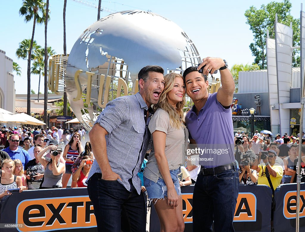 <a gi-track='captionPersonalityLinkClicked' href=/galleries/search?phrase=Eddie+Cibrian&family=editorial&specificpeople=689383 ng-click='$event.stopPropagation()'>Eddie Cibrian</a>, <a gi-track='captionPersonalityLinkClicked' href=/galleries/search?phrase=LeAnn+Rimes&family=editorial&specificpeople=208815 ng-click='$event.stopPropagation()'>LeAnn Rimes</a> and <a gi-track='captionPersonalityLinkClicked' href=/galleries/search?phrase=Mario+Lopez&family=editorial&specificpeople=235992 ng-click='$event.stopPropagation()'>Mario Lopez</a> visit 'Extra' at Universal Studios Hollywood on July 23, 2014 in Universal City, California.