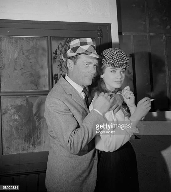 Eddie Constantine and Genevieve Grad in the film of Pierre Grimblat 'L'Empire de la nuit' France 1962