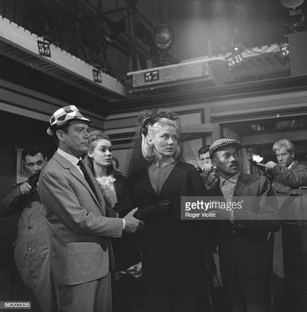 Eddie Constantine Elga Andersen Harold Nicholas and Genevieve Grad in the film of Pierre Grimblat 'L'Empire de la nuit' France 1962