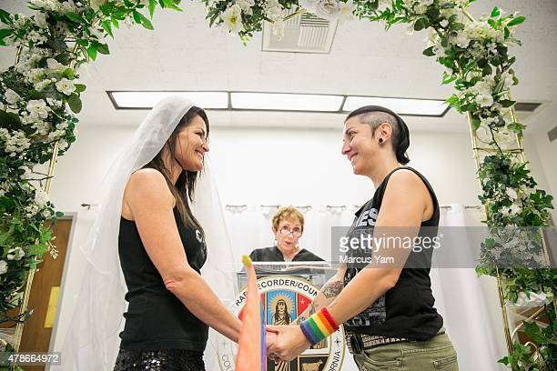 Eddie Daniels and Natalie Novoa say their vows during their wedding ceremony at the LA County Registrar office on June 26 2015 in Beverly Hills...