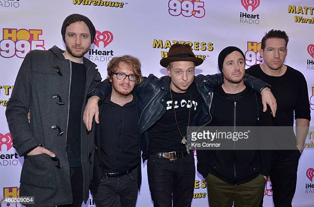 Eddie Fisher Drew Brown Zach Filkins Ryan Tedder and Brent Kutzle of OneRepublic pose for photographers in press room during Hot 995's Jingle Ball on...