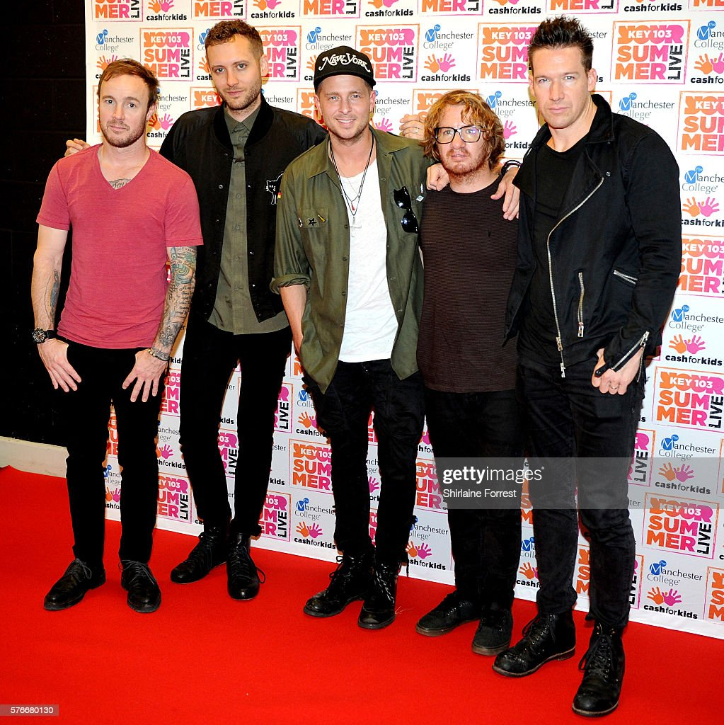 Eddie Fisher Zach Filkins Ryan Tedder Drew Brown and Brent Kutzle of One Republic pose before performing at Key 103 Live at Manchester Arena on July...