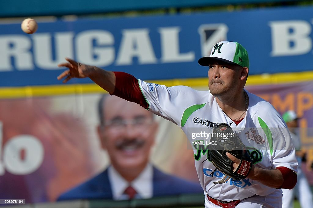 Eddie Gamboa of Mexico pitches against Venezuela during their 2016 Caribbean baseball series game on February 7, 2016 in Santo Domingo, Dominican Republic. AFP PHOTO/YAMIL LAGE / AFP / YAMIL LAGE