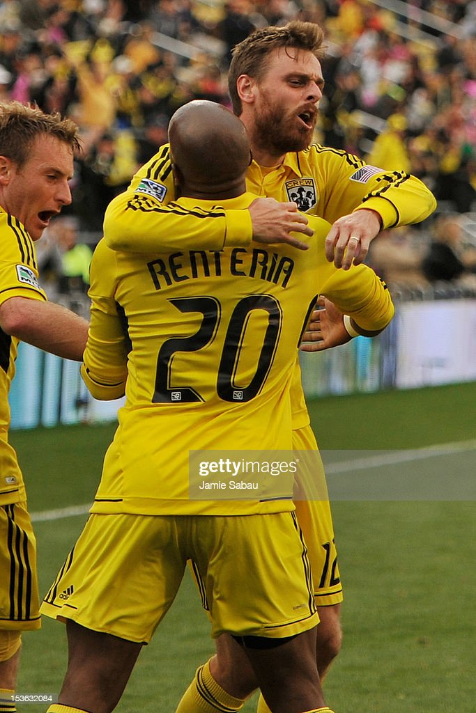 Eddie Gaven #12 of the Columbus Crew celebrates his goal in extra time against Sporting Kansas City with teammate Emilio Renteria #20 on October 7, 2012 at Crew Stadium in Columbus, Ohio. Columbus and Sporting Kansas City played to a 1-1 tie.