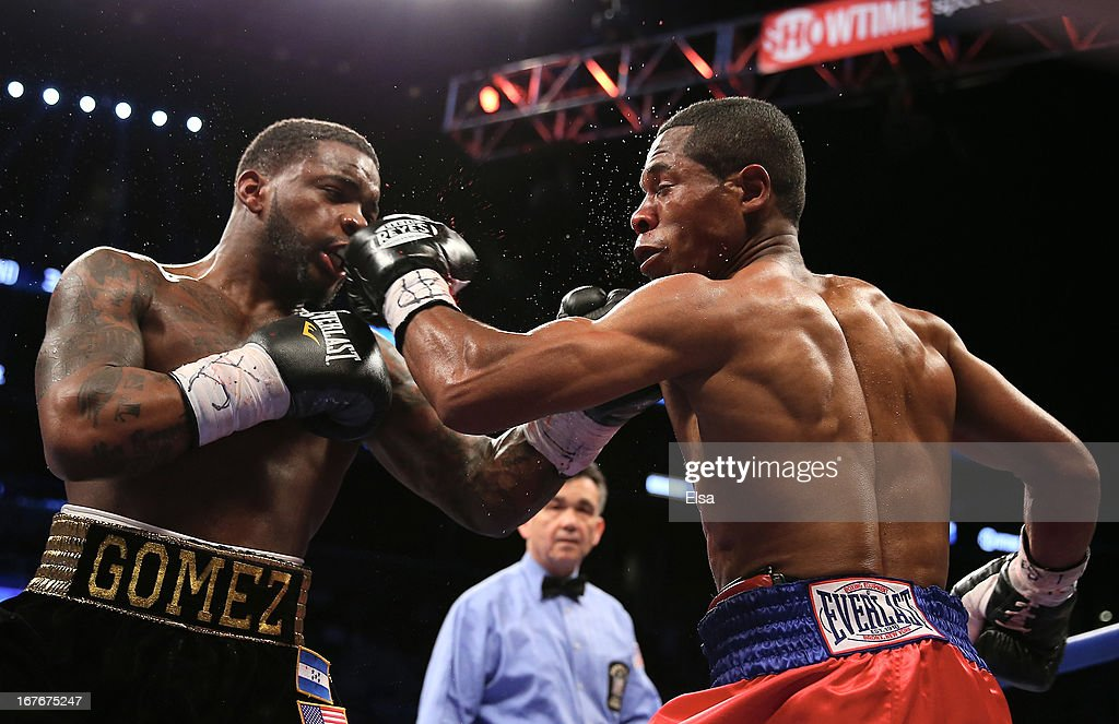 Eddie Gomez hits Luis Hernandez at Barclays Center on April 27, 2013 in the Brooklyn borough of New York City.