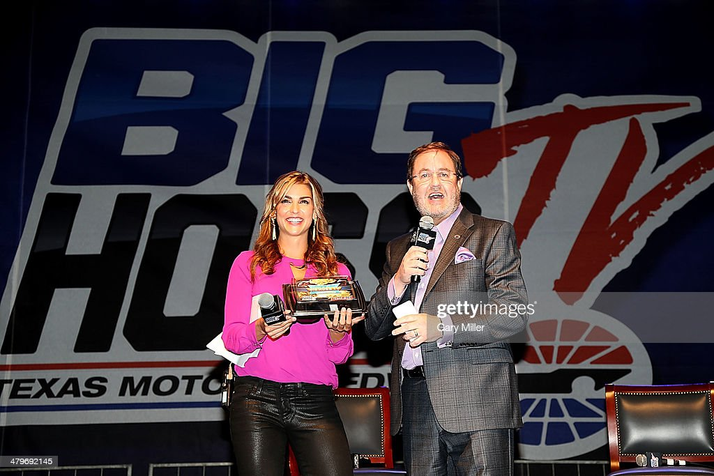 Eddie Gossage (R) and Paige Duke speak during the unveiling of 'Big Hoss' the largest HD video board in the world at Texas Motor Speedway on March 19, 2014 in Fort Worth, Texas.