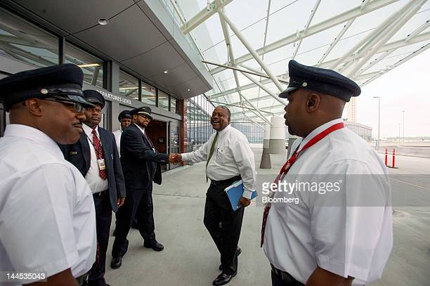 Eddie Harris director of Skycaps for Delta Air Lines center talks with his team about procedures for the opening of the Maynard H Jackson Jr...
