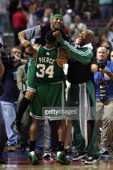 Eddie House jumps into the arms of teammate Paul Pierce and Sam Cassell of the Boston Celtics as they celebrate their win over Detroit Pistons and...