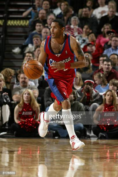 Eddie House of the Los Angeles Clippers takes the ball up the court during a game against the Portland Trail Blazers on March 24 2004 at the Rose...
